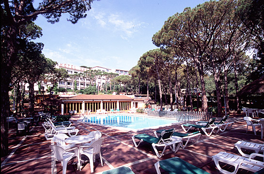 The Hotel Garbi's shady outdoor pool and bar